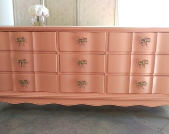 SOLD - -  Gorgeous refinished coral dresser with bow detailed hardware