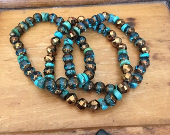 Genuine turquoise, turquoise and bronze glass beads in a triple strand bracelet