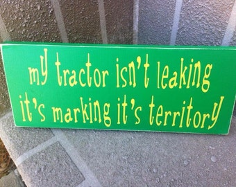 Farming, my tractor isn't leaking, wooden sign