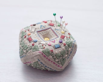 PIN CUSHION  biscornu with cross stitch leaves and fiber bobins