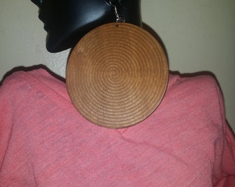 Large, round brown wooden earrings.