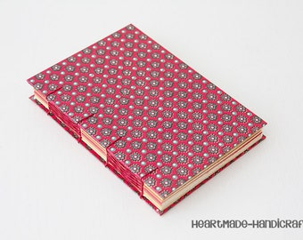 A6 Notebook / coptic bookbinding in red