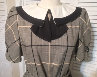 Vintage 1980's black and cream plaid dress with pleated skirt, oversized bow and collar