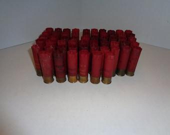 56 Red 12 Gauge Empty Shotgun Shells Copper Bottoms