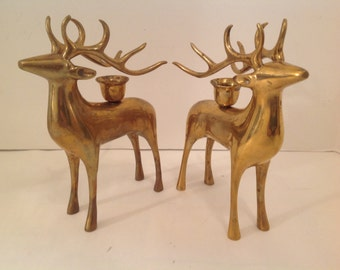 pair of brass reindeer candle holders