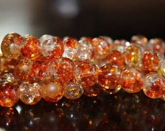 80 approx. shades of orange, yellow and clear 10 mm crackle glass beads, 1.5 mm hole