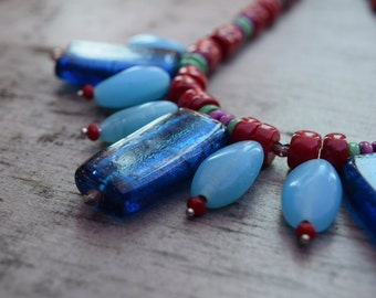 Toffee Wrapper Blues: A bold statement necklace in Red Coral, Indian blue glass and Semi Precious Stone
