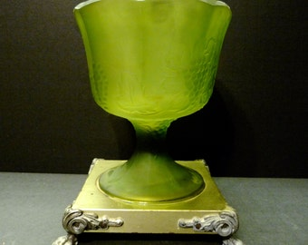 Vintage unusual frosted green glass compote with metal legged base.