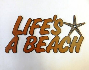 Lifes a Beach with Starfish sign made out of rusted metal