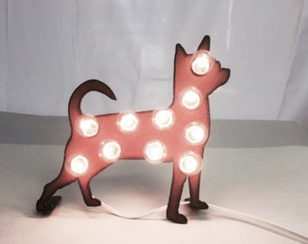 Chihuahua marquee lighted sign made out of rusted metal