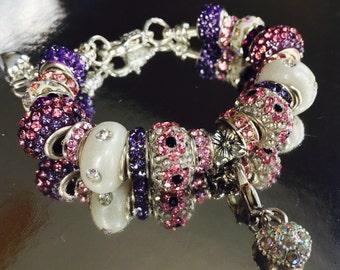 Pink/purple charm bracelet.