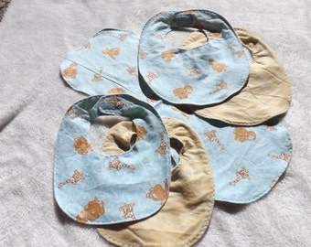 baby bib, newborn bib, and burp cloth made from Curious George playing with giraffee flannel w/ coordinating backing making it reversible