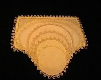 A set of ten matching Doilies with crochet edges