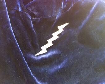 Silver lightning bolt brooch