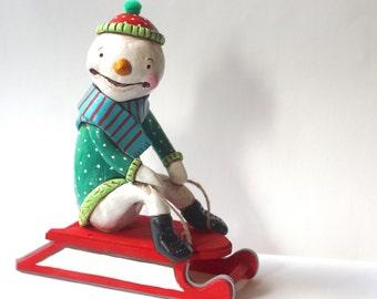 Jolly Snowman on Wooden Sled Folk art sculpture from polymer clay
