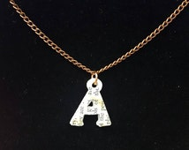 Alphabet charm necklace made from old book pages. A necklace with 20 inch chain