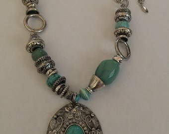 Hand made silver tone and faux turquoise medallion necklace with rhinestone accents