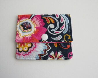 Compact Snap Wallet with card slots, and a pocket at the back for folded cash or receipts. Pink, Blue, Flowers