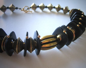 Eye of the Tiger: Faux brass, palm wood, gold fill. Necklace and earring set.