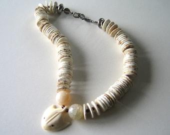 Disco Ray: Carved bone, soapstone, Swarovski crystal. Necklace and earring set.