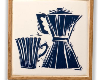 Ceramic trivets or coasters; oak framed handmade tile with a screen printed linocut design