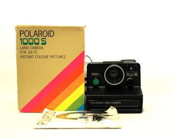 Polaroid 1000S Land Cámera - green button [includes original box and original book instruccions]
