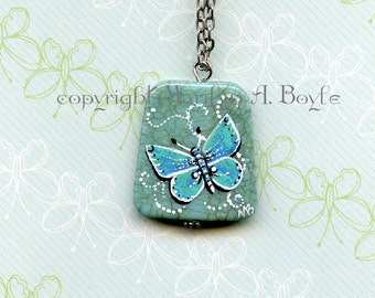 HAND PAINTED STONE; Butterfly, sea blue color, wearable art, pendant, 20 inch chain,nature,