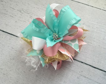 Aqua, light pink and gold bow