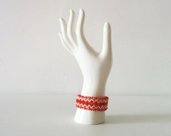 Crochet bracelet with red crystals