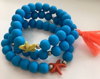 Royal blue elastic beaded bracelets w starfish details