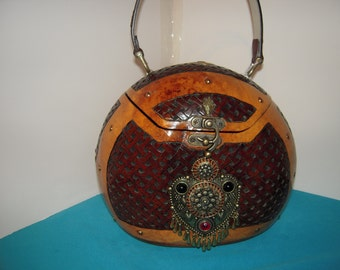 """We call this beautiful purse """"The Persian"""" because of the exotic heartshaped inlaid cabachon."""