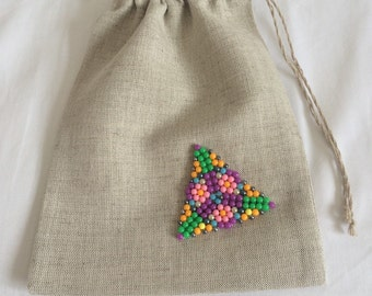 Small linen gift bag with beads.
