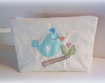 Pouch with embroidered bird