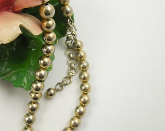 "MONET Margaret Necklace 1950's Gold Tone Beads Strung in a Gold Chain 14"" long Great Used Condition"
