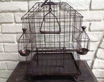 Vintage reproduction old metal birdcage