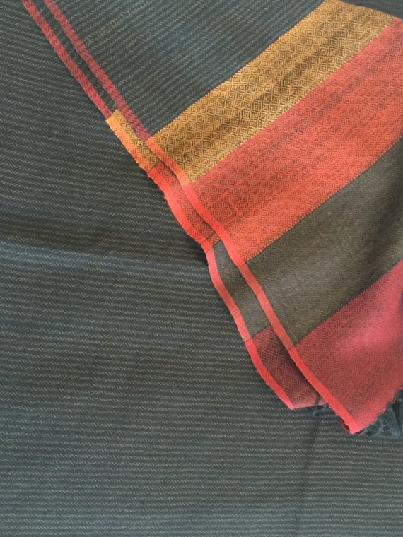 Pure wool scarf stole shawl in rich vibrant colors Black with narrow striped pattern bordered with broad splash of red and yellow
