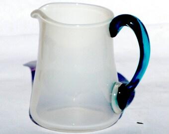Soft white pitcher.