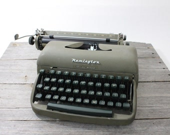 Mid-1950s Remington Travel-Riter portable typewriter in hard-shell case. Made in Holland and in good condition.
