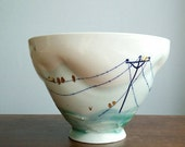 Handmade bowl. Gold birds on a wire.