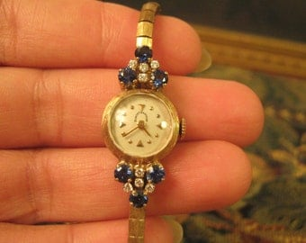 """Vintage """"Robertanstead"""" 14K Solid Gold Diamond and Blue Sapphire Lady wrist watch. 15.3 grams."""