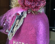 Pink Glitter Patron Bottle with Beaded Flower