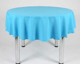 Turquoise Round Tablecloth - Made from polyester fabric not cotton.