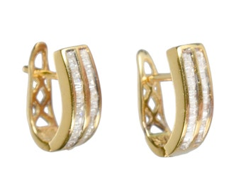 pair of 14k and channel set diamond earrings