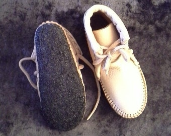 Buffalo hide Moccasins with deerskin lining with a Buffalo and sheepskin insole and a custom rubber bottom
