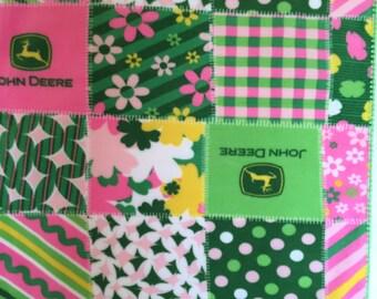 Pink and green John Deere fleece blanket