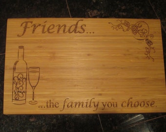 Friends... the family you choose.  Large personalized bamboo cutting board.