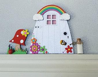 Fairy door rainbow fairy door hand painted by doodledotdorset for Painted fairy doors