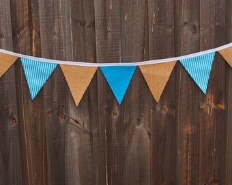 Rustic burlap and blue cotton bunting with stripes.