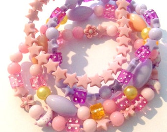 Girls candy stackable bracelets in pastel pinks