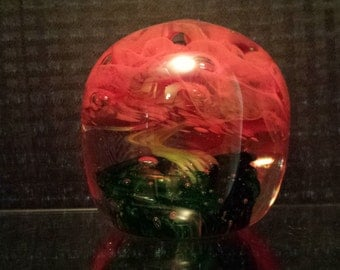 Red and green floral paperweight